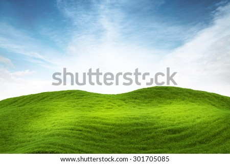 3d illustration of green grass hill under blue sky - stock photo