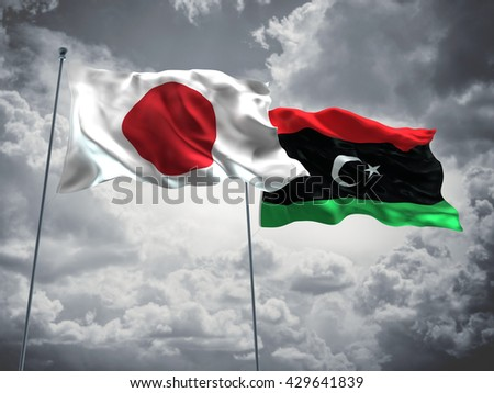 3D illustration of Japan & Libya Flags are waving in the sky with dark clouds  - stock photo