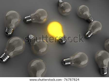 3d illustration of light bulbs with one shining - stock photo