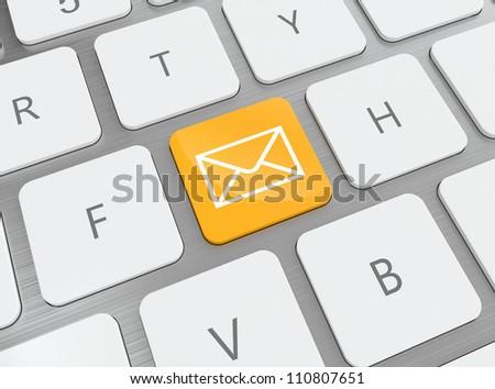 3D illustration of orange e-mail button on keyboard - stock photo