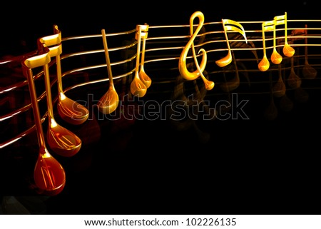 3d image of golden musical string with note - stock photo