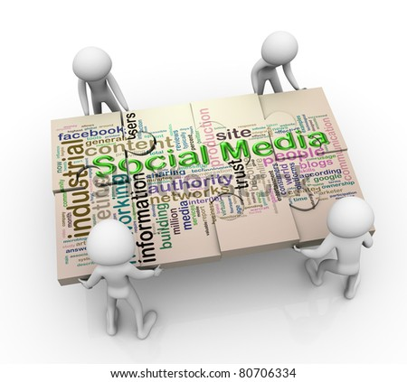 3d men working together for completing puzzle of 'social media wordcloud' - stock photo