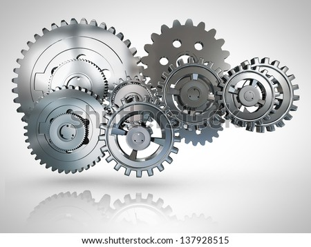3D metallic cogwheels engaged - over a white background - stock photo
