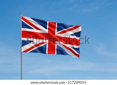 3d model of a waving UK flag. Blue sky background. - stock photo