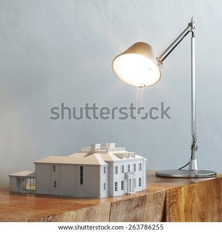 3d model of building under the desk lamp light stand on vintage wooden table - stock photo