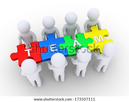 3d people holding puzzle pieces with TEAM letters on them - stock photo