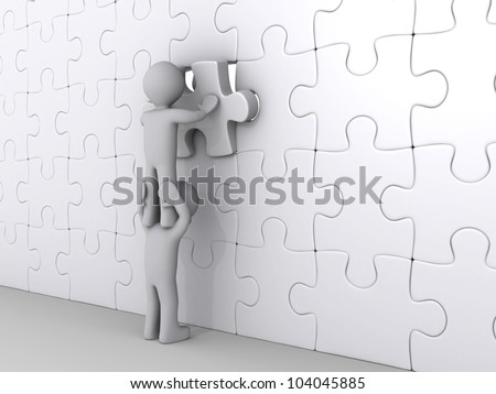 3d person on top of another is putting last piece of puzzle - stock photo