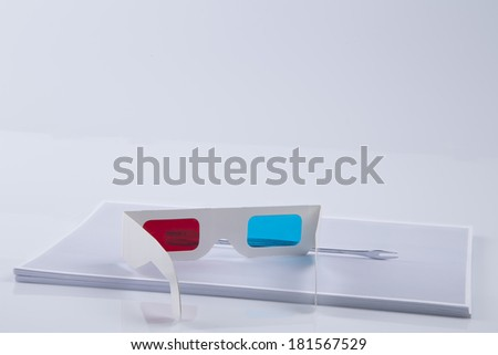 3D Print: white 3D anaglyphic Red Blue glasses and paper printed wrench. 3D Printers allow faster prototyping times transforming printing shapes in solid objects at home in no costs - stock photo