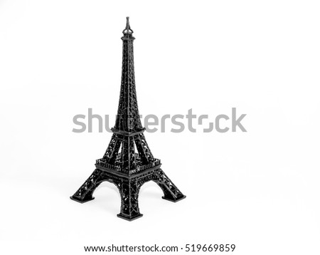 3d-printed black model of Eiffel Tower. White background.