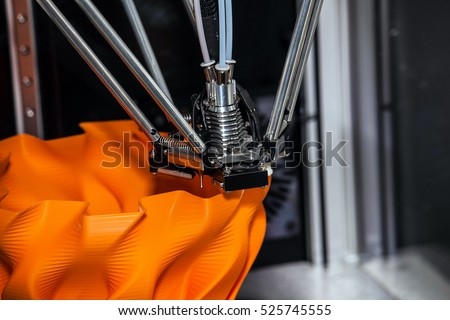 3d printer printing. Close up process of new printing technology