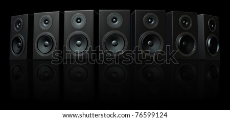 3D Render of loud speakers on a black reflective background