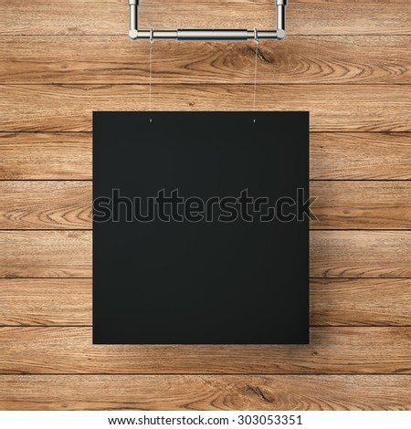 3d rendered black blank frame hanging on timber wall