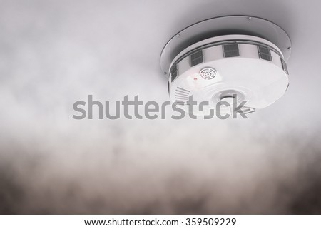 3d rendered smoke detector on ceiling with blank space