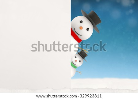 3d rendered snowman hiding on blue background - stock photo