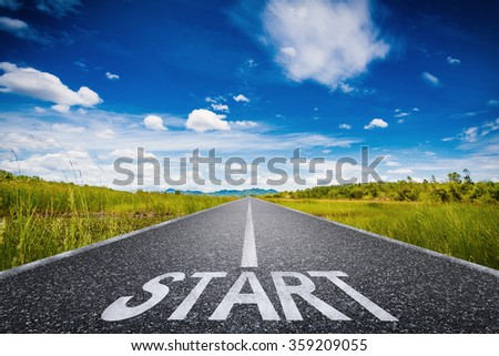 3d rendered start text on long road with green field and blue sky illustration - stock photo