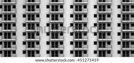 3D rendering of a highrise facade with anonymous apartments with balcony - stock photo