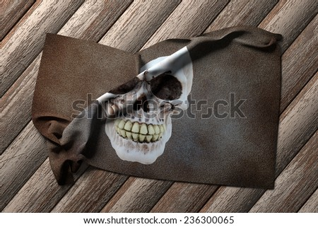 3d rendering of a pirate flag on a wooden table - stock photo