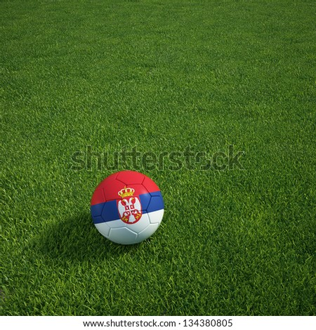3d rendering of a Serbian soccerball lying on grass - stock photo