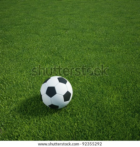 3d rendering of a soccerball lying on grass - stock photo