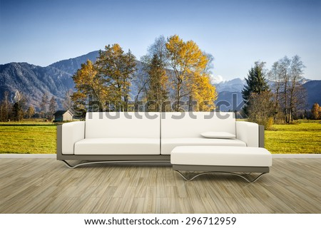3D rendering of a sofa in front of a photo wall mural autumn landscape - stock photo
