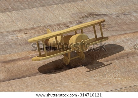 3d rendering of a wooden airplane on a wooden background