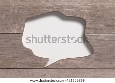 3d rendering of carved speech bubble in wooden planks - stock photo
