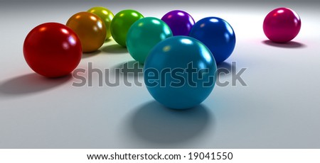 3D rendering of colourful balls on a white background