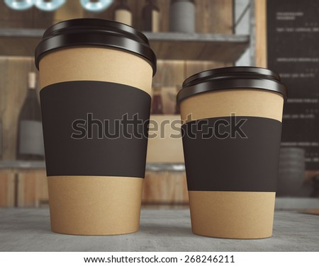 3D rendering of cups on table - stock photo