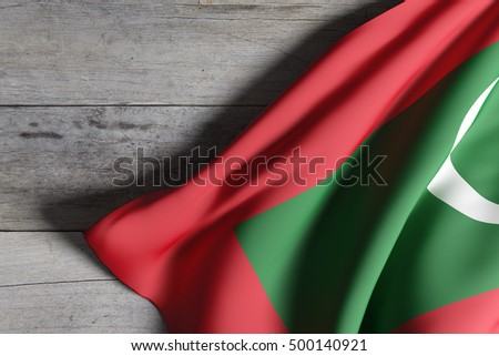 3d rendering of Republic of Maldives flag waving on wooden background