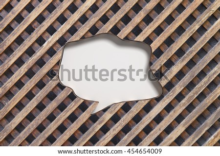 3D rendering of speech bubble with blank space carved in wooden fence background - stock photo