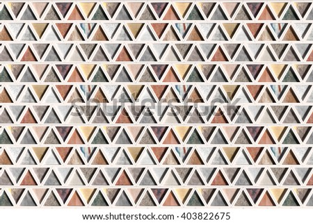 3d rendering wall with triangles of different materials in white frames. Close-up - stock photo