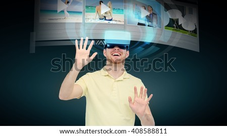 3d technology, virtual reality, cyberspace, entertainment and people concept - happy young man with virtual reality headset or 3d glasses watching video records on media player over black background