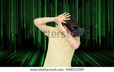 3d technology, virtual reality, entertainment and people concept - scared young man with virtual reality headset or 3d glasses playing game and covering from something over binary code background - stock photo