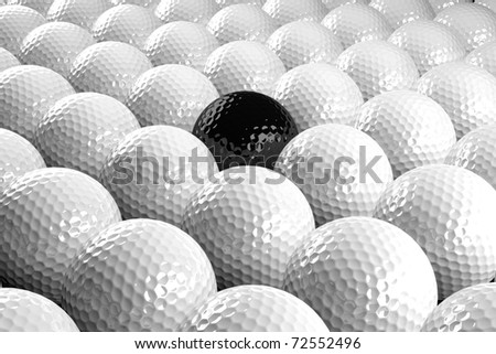 3d White Golf balls & one black in the middle - stock photo