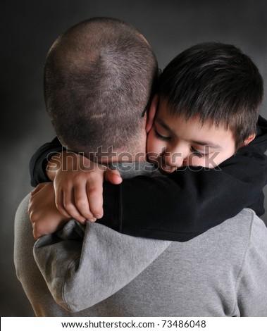 dad hugging his son - stock photo
