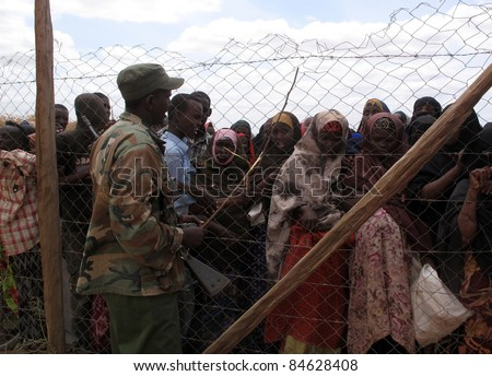 DADAAB, SOMALIA-AUGUST 15: Unidentified womens live in the Dadaab refugee camp where thousands of Somalis wait for help because of hunger on August 15, 2011 in Dadaab, Somalia. - stock photo