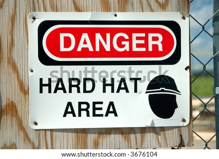 'Danger Hard Hat Area' warning sign.