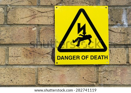 'danger of Death' warning sign for electricity on a wall concept - stock photo