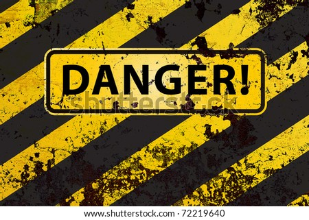 """""""Danger"""" on the grunge yellow-black striped  background - stock photo"""