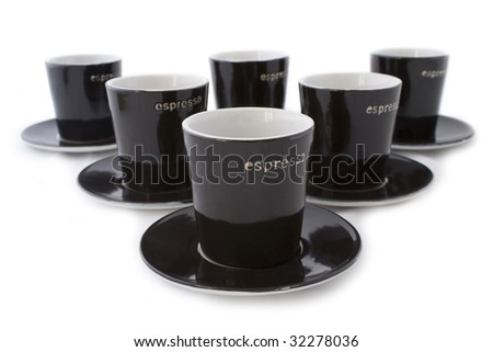 6 dark brown espresso cups and plates isolated on a white background