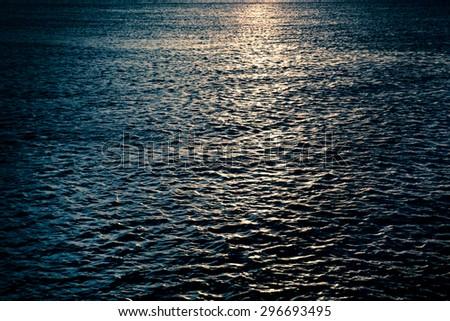Dark ocean with moonlight - stock photo