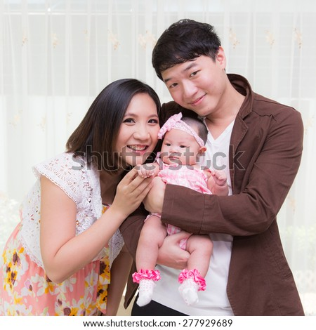 55 day baby feeling happy  with mother and father - stock photo