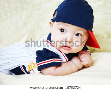100 days baby wearing sports hat. - stock photo