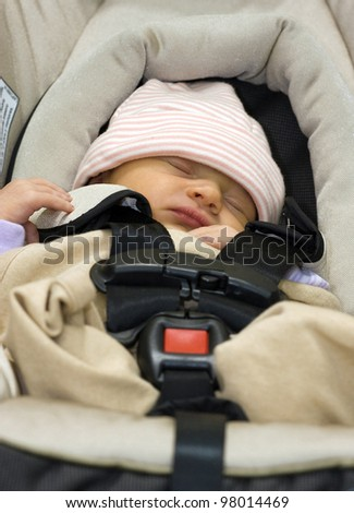 3 days old baby girl sleeping in a safety infant car seat/carrier - stock photo