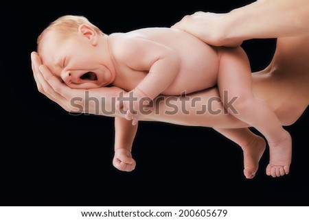 5 days old baby in fathers arms - stock photo