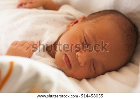 12 days old newborn sleeping close up