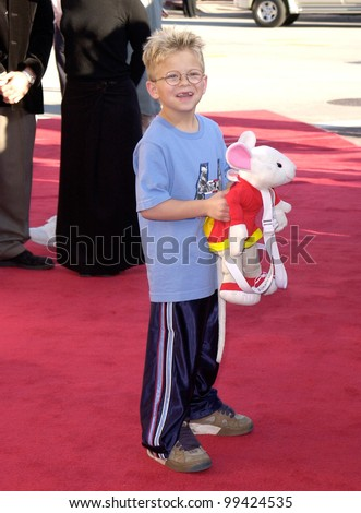 "05DEC99: Actor JOHNATHAN LIPNICKI with ""Stuart Little"" at the world premiere in Los Angeles of his new movie ""Stuart Little"" in which he stars with Geena Davis.  Paul Smith / Featureflash"