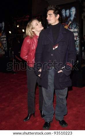 "16DEC99: Backstreet Boys star KEVIN RICHARDSON & girlfriend at the world premiere, in Los Angeles, of Oliver Stone's ""Any Given Sunday"" which stars Al Pacino & Cameron Diaz.  Paul Smith / Featureflash - stock photo"