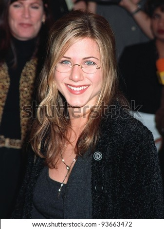 "02DEC97:  ""Friends"" star JENNIFER ANISTON at the premiere of ""Good Will Hunting,"" which stars Robin Williams, Matt Damon & Ben Affleck. - stock photo"