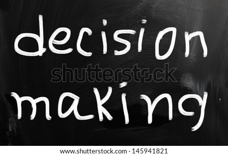 """""""Decision making"""" handwritten with white chalk on a blackboard - stock photo"""